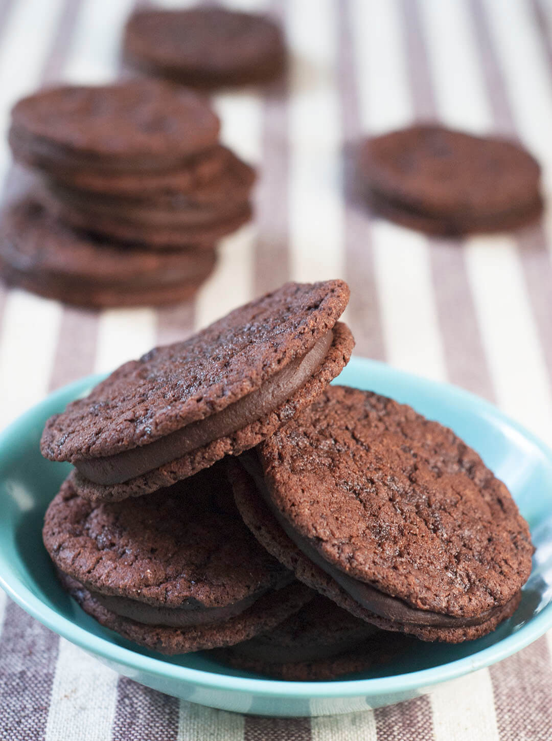Chocolate cookies with ganache filling in a bowl